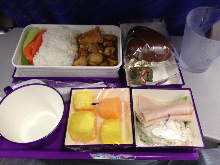 Chicken and rice, with potato salad, ham, fresh fruits, and yogurt