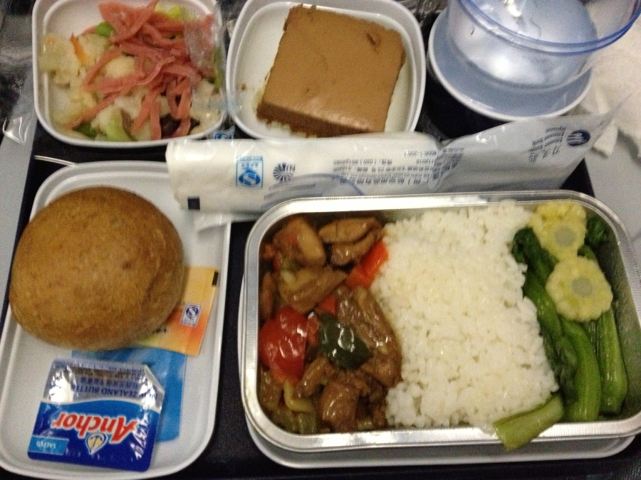Chicken with rice and vegetables, weird mousse cake, dinner roll, salad